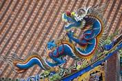 Une sculpture sur bois dans le temple de Hsing Tien